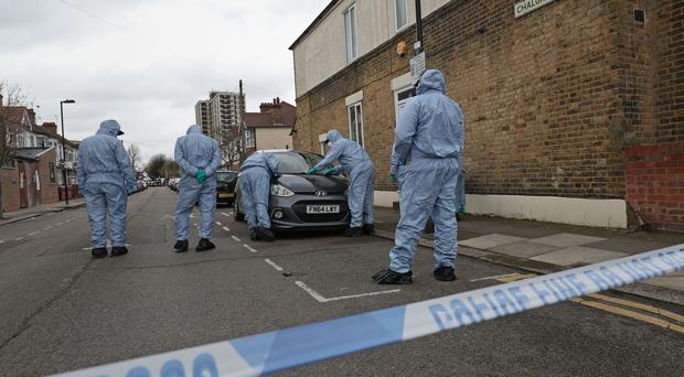 Forensic officers search Chalgrove Road in Tottenham (Jonathan Brady/PA)