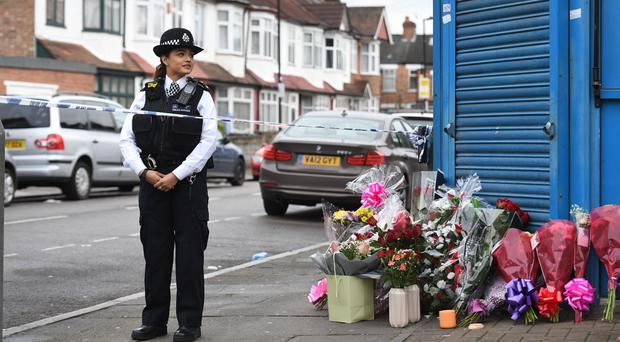 Floral tributes left on Chalgrove Road, Tottenham, north London, where a 17-year-old girl was shot dead Victoria Jones/PA)