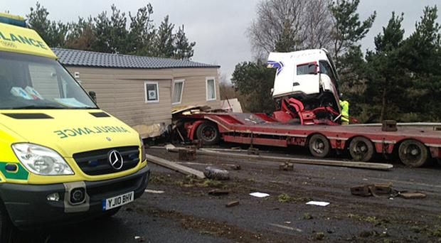 The scene on the M62 near the Ouse Bridge at Goole, where a lorry carrying a static caravan went through the central reservation and hit a car (Steve White/PA)
