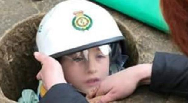 Max Morgan, seven, became stuck in the stone monument after his leg got trapped (West Midlands Fire Service/PA)