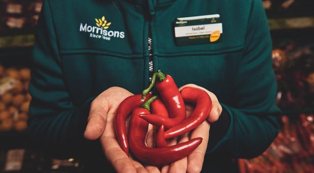 Morrisons is to sell wonky chillies and has pledged to sell more wonky fruit and vegetables after listening to customers' concerns about food waste (Mikael Buck/Morrisons)