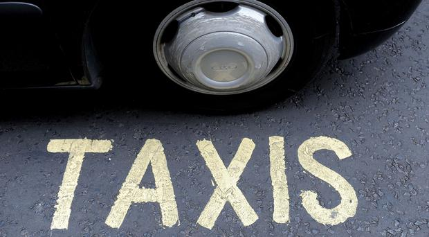 A Belfast taxi firm was picketed by workers yesterday over complaints of pay disparity.