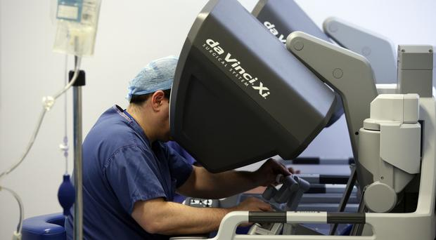 Surgeons using the da Vinci Xi surgical system (Jonathan Brady/PA)