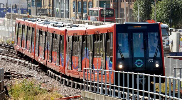 Workers on London's Docklands Light Railway will strike for four days (John Stillwell/PA)