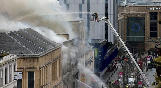More than 120 firefighters tackled the Sauchiehall Street blaze last month (Jane Barlow/PA)