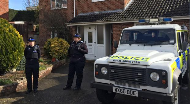 Officers outside the Salisbury home of Sergei Skripal (Ben Mitchell/PA)