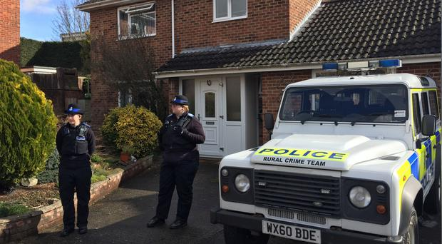Police Community Support Officers standing outside the Salisbury home of Sergei Skripal, who is no longer in a critical condition (Ben Mitchell/PA)