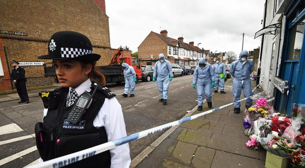Forensic officers search Chalgrove Road in Tottenham (Victoria Jones/PA)