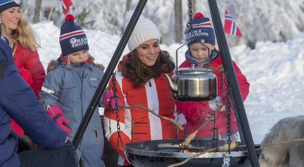 The Duchess of Cambridge with children at a camp fire as she attends an event in Tryvann, Oslo, Norway (Arthur Edwards/The Sun/PA)