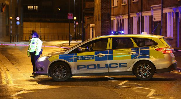 A police road block in Hackney, east London, after a man in his 20s died after being stabbed (Jonathan Brady/PA)