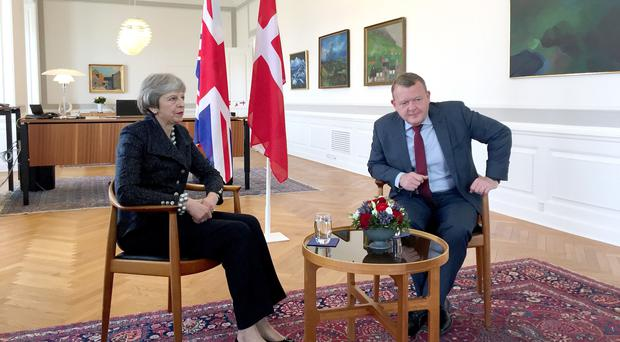 Theresa May alongside Danish PM Lars Rasmussen inside Christiansborg Castle, Copenhagen (Harriet Line/PA)
