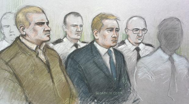 Corporal Mikko Vehvilainen and Private Mark Barrett (centre) are on trial, alongside another man, at Birmingham Crown Court (Elizabeth Cook/PA)