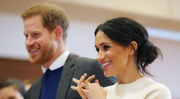 Prince Harry and Meghan, pictured during a visit to Northern Ireland, have not invited any politicians to their wedding but ordinary heroes have received invites (Niall Carson/PA)