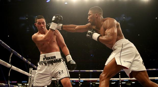 Anthony Joshua (right) lands a punch on Joseph Parker at the Principality Stadium, Cardiff. New research suggests that blows to the head can increase dementia risk. (Nick Potts/PA)