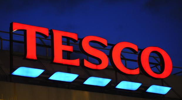 Tesco has defied mounting gloom on the high street to post a better-than-expected jump in annual profits as revival efforts steer the group back to its former glory.