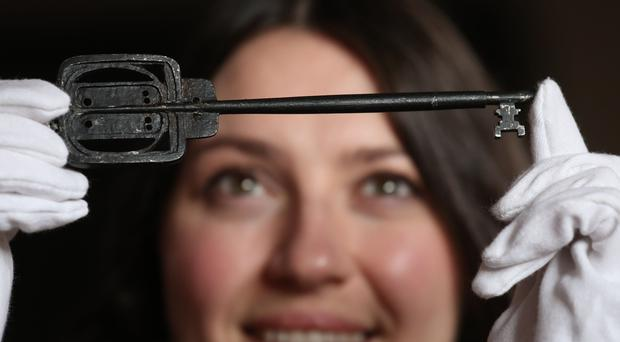 Charlotte Riordan from Lyon and Turnbull with the key used to open Glasgow School of Art in 1899 (Andrew Milligan/PA)