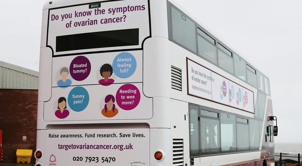 A Lothian bus highlighting the symptoms of ovarian cancer (Lothian/PA)