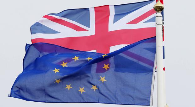 A new report examines the settled status scheme for EU citizens living in the UK (Niall Carson/PA)