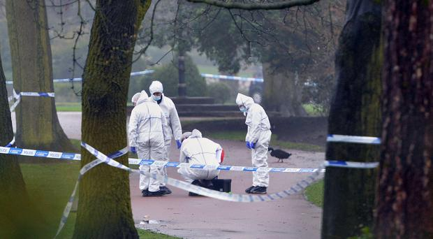 Police at the scene after a girl's body was found in West Park, Wolverhampton (PA)