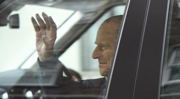 The Duke of Edinburgh leaving the King Edward VII Hospital in London after recovering from a planned surgery last Wednesday to replace his joint with a prosthetic implant.