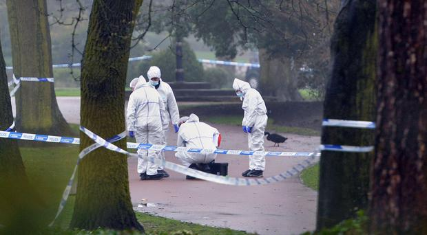 Police at the scene after a girl's body was found in West Park, Wolverhampton