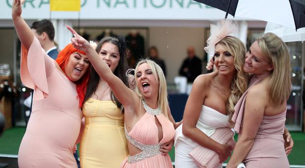 Racegoers during Ladies Day at the 2018 Randox Health Grand National Festival at Aintree (David Davies/PA)