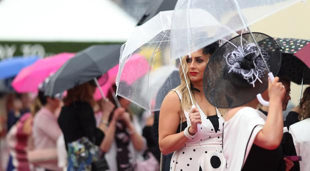 Wet weather did not dampen spirits at Aintree's Ladies Day (David Davies/PA)