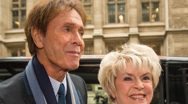 Sir Cliff Richard arrives with Gloria Hunniford at court to give evidence in a legal battle against the BBC (Dominic Lipinski/PA)