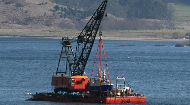 The Nancy Glen was lifted on to a barge on Thursday (Andrew Milligan/PA)