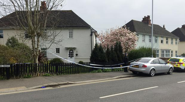 Police at the scene on South Farm Road in Worthing where a man and a woman were found dead at a house (Flora Thompson/PA)