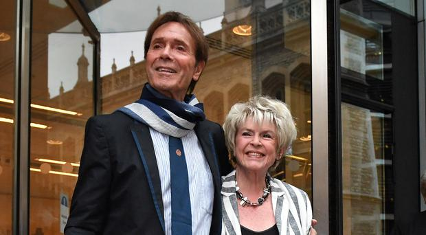 Sir Cliff Richard leaves the Rolls Building, with Gloria Hunniford, where he gave evidence in a legal battle with the BBC (Dominic Lipinski/PA)