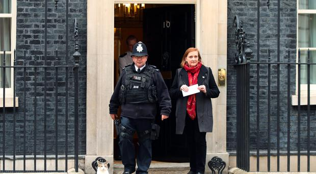 Emma Dent Coad delivering a letter on behalf of Stop the War Coalition at 10 Downing Street (Yui Mok/PA)