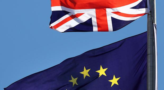 The Union flag and the EU flag (Jane Barlow/PA)