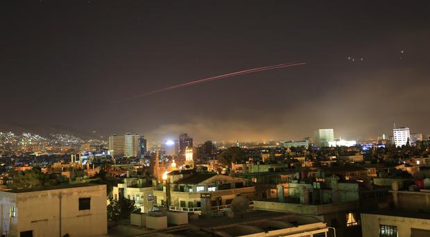 Damascus skies erupt with anti-aircraft fire as the US launches an attack on Syria (Hassan Ammar/AP)