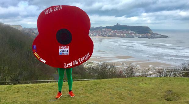 Owen Willis is to tackle the London Marathon dressed in a poppy suit (Royal British Legion/PA)