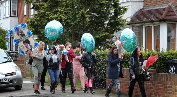 Friends and relatives of Henry Vincent bring birthday tributes to at the scene in Hither Green (Gareth Fuller/PA)