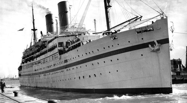 The Empire Windrush, pictured her in 1954, brought Commonwealth immigrants to the UK (PA)