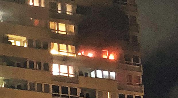 Picture taken with permission from the Twitter feed of @i_JustaDream showing smoke billowing from the windows of a flat on the 17th floor of a tower block in Stratford, east London (@i_JustaDream/PA)