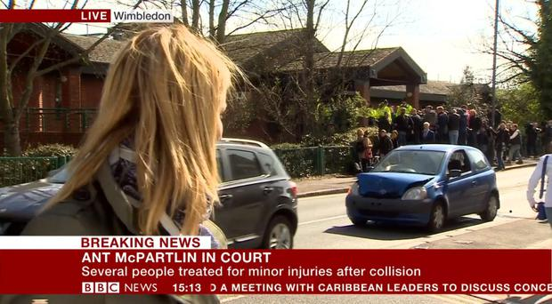 BBC reporter Alison Freeman, who was outside Wimbledon Magistrates' Court where Ant McPartlin was appearing on drink- driving charges, looking at one of the vehicles involved in a collision behind her (BBC Breakfast/PA)