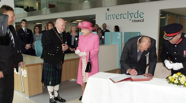 Robert Moran met the Queen and Duke of Edinburgh in 2012 (Inverclyde Council/PA)