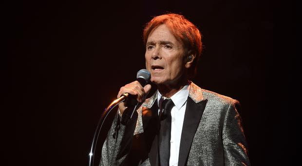 Sir Cliff Richard received damages from South Yorkshire Police following a raid on his house (PA)