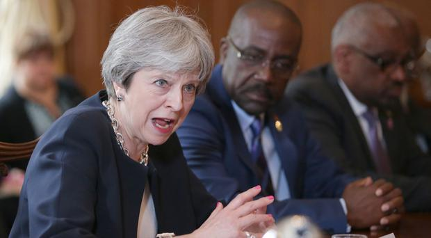 Theresa May has apologised to Caribbean leaders over threats to deport 'Windrush generation' immigrants (Daniel Leal-Olivas/PA)