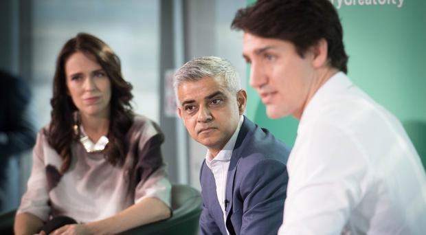 Sadiq Khan, centre, with Jacinda Ardern and Justin Trudeau (Stefan Rousseau/PA)