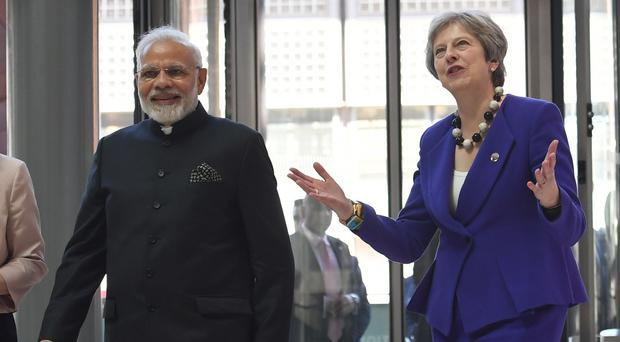 Indian Prime Minister Narendra Modi with Prime Minister Theresa May at the Francis Crick Institute in London (Stefan Rousseau/PA)