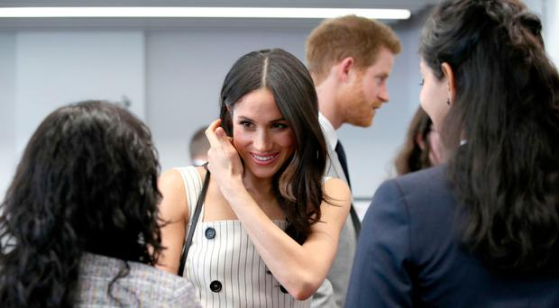 Meghan Markle and Prince Harry attend a reception with delegates from the Commonwealth Youth Forum during the Heads of Government Meeting