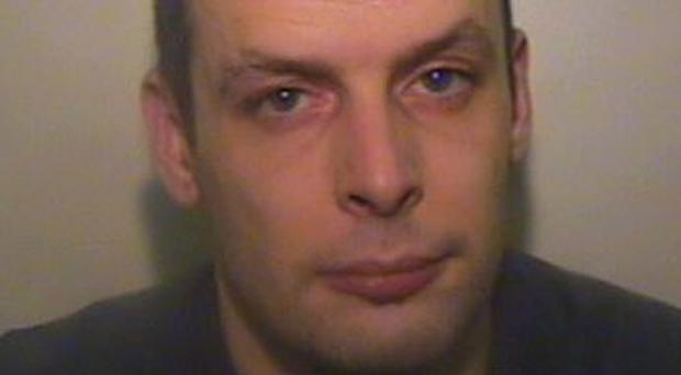 Adam Wyatt was jailed for owning and sharing terrorist material (Greater Manchester Police/PA)