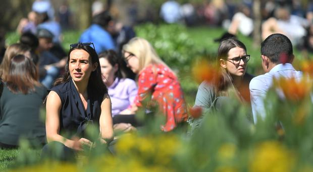 Sun-seekers enjoy the hot spell in St James' Park, London (Victoria Jones/PA)