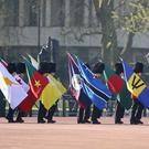A Guard of Honour carrying the 53 Commonwealth flags arrive at Buckingham Palace (Gareth Fuller/PA)
