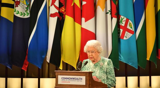 The Queen speaks at the formal opening of the Commonwealth Heads of Government Meeting at Buckingham Palace (Dominic Lipinski/PA)
