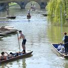 People punt along the River Cam in Cambridge on what is expected to be the hottest day of the year so far (Joe Giddens/PA)